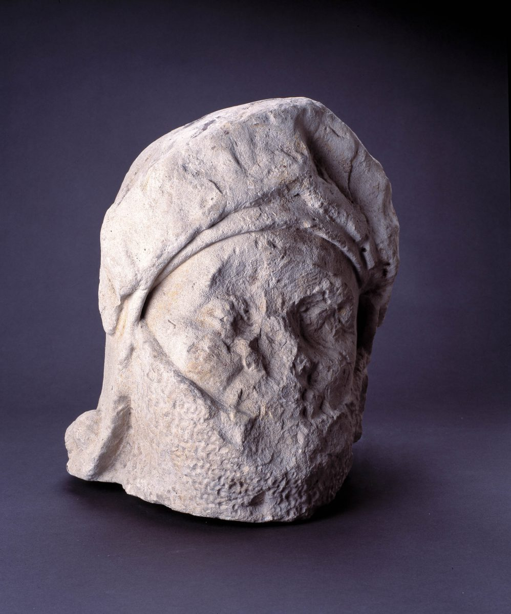 Helmeted head in stone